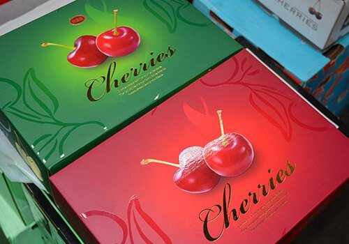 Branded NZ Cherry Corp boxes containing cherries