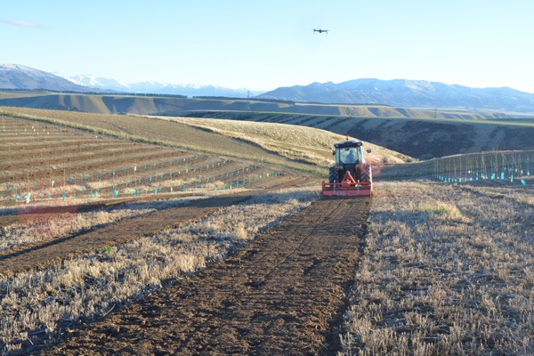 Tractor harvest land for a cherry orchard