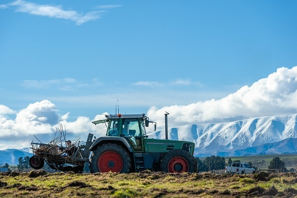 Tractor with snowy mountains in the background